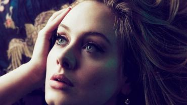 Adele dá selinho em fã